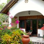 Four private bungalows are set in a tranquil lush green garden and decorated in an Indonesian style
